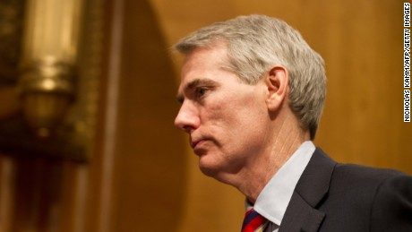 US Republican Senator from Ohio Rob Portman leaves the room as acting US Trade Representative Demetrios Marantis testifies before the Senate Finance Committee on the President's 2013 Trade Agenda on Capitol Hill in Washington on March 19, 2013.