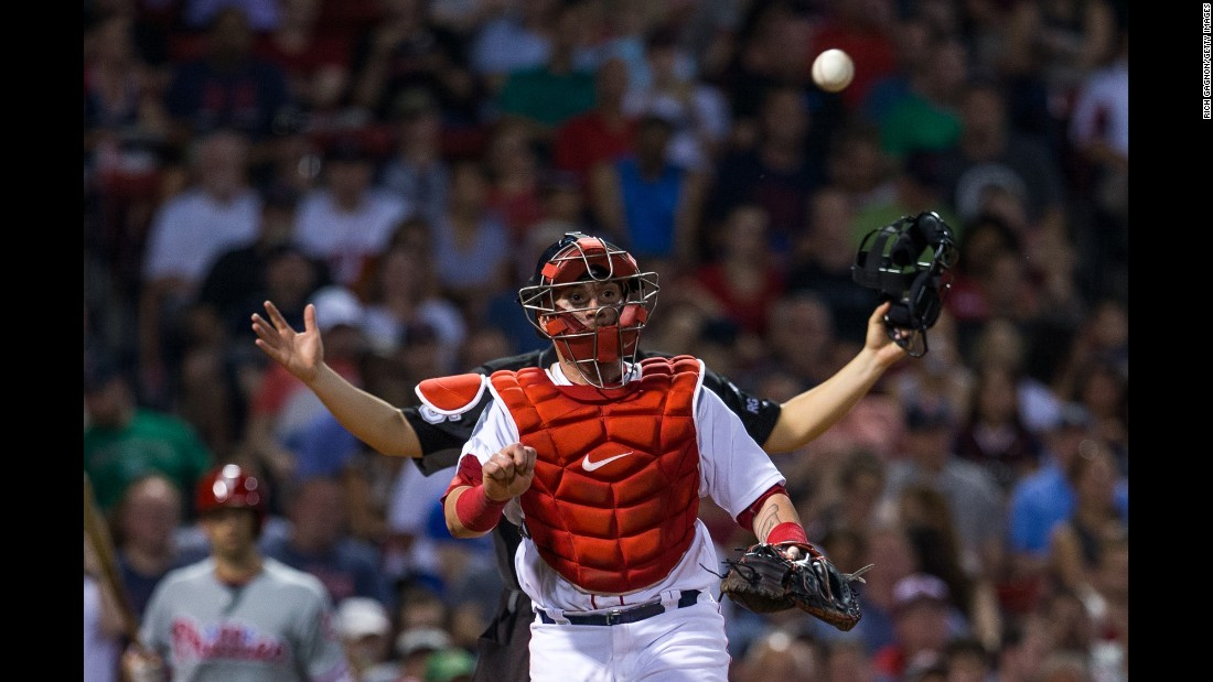 An umpire stands behind Boston catcher Christian Vazquez during a game on Tuesday, June 13.