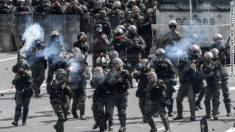 TOPSHOT - Riot police confront opposition activists during clashes in a demonstration against the government of President Nicolas Maduro along the Francisco Fajardo highway in Caracas on June 19, 2017. Near-daily protests against President Nicolas Maduro began on April 1, with demonstrators demanding his removal and the holding of new elections. The demonstrations have often turned violent with 73 people killed and more than 1,000 injured so far, prosecutors say, and more than 3,000 arrested, according to the NGO Forum Penal.  / AFP PHOTO / Juan BARRETO        (Photo credit should read JUAN BARRETO/AFP/Getty Images)