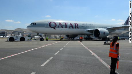 A Qatar Airways Boeing 777-300 is moved on the Tarmac of Le Bourget airport on June 18, 2017 on the eve of the opening of the International Paris Air Show. Saudi Arabia, the United Arab Emirates, Bahrain and Egypt are among several countries that suspended ties with Qatar last week, including the suspension of all flights to and from Doha and an airspace ban on Qatar Airways.  / AFP PHOTO / ERIC PIERMONT        (Photo credit should read ERIC PIERMONT/AFP/Getty Images)