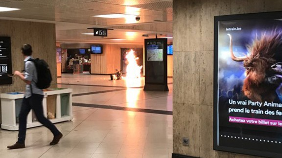 Flames are visible Tuesday night after a suitcase was detonated in Brussels Central Station.