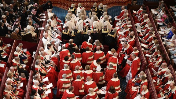 Peers take their seats in the House of Lords before the Queen