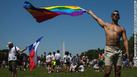 WASHINGTON, DC - JUNE 11: A demonstrator waves a rainbow flag on the National Mall during the Equality March for Unity and Peace on June 11, 2017 in Washington, D.C. Thousands around the country participated in marches for the LGBTQ communities, the central march taking place in Washington.  (Photo by Zach Gibson/Getty Images)