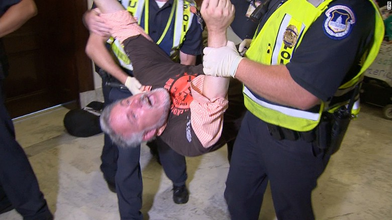 Protesters dragged away from senator's office