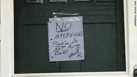 "A note saying ""NO interviews"" was taped to the door of a juror's home."