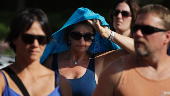 A woman shields herself from the sun while walking along the Las Vegas Strip on June 20.