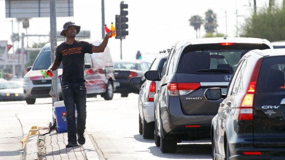 Eric Maurice Clark sells cold drinks to motorists at a busy intersection in Phoenix on June 20.