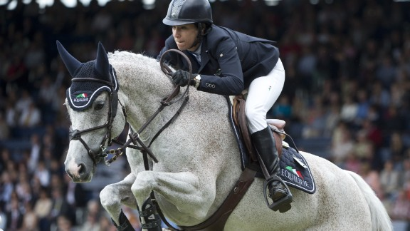 US American Laura Kraut on Cedric clears an obstacle during the North Rhine Westphalia jumping prize at the CHIO World Equestrian Festival in Aachen on July 6, 2012.  Kraut took third place. The CHIO, the last major equestrian event before the London Olympics, takes place from 03 to 08 July AFP PHOTO / JOHN MACDOUGALL        (Photo credit should read JOHN MACDOUGALL/AFP/GettyImages)