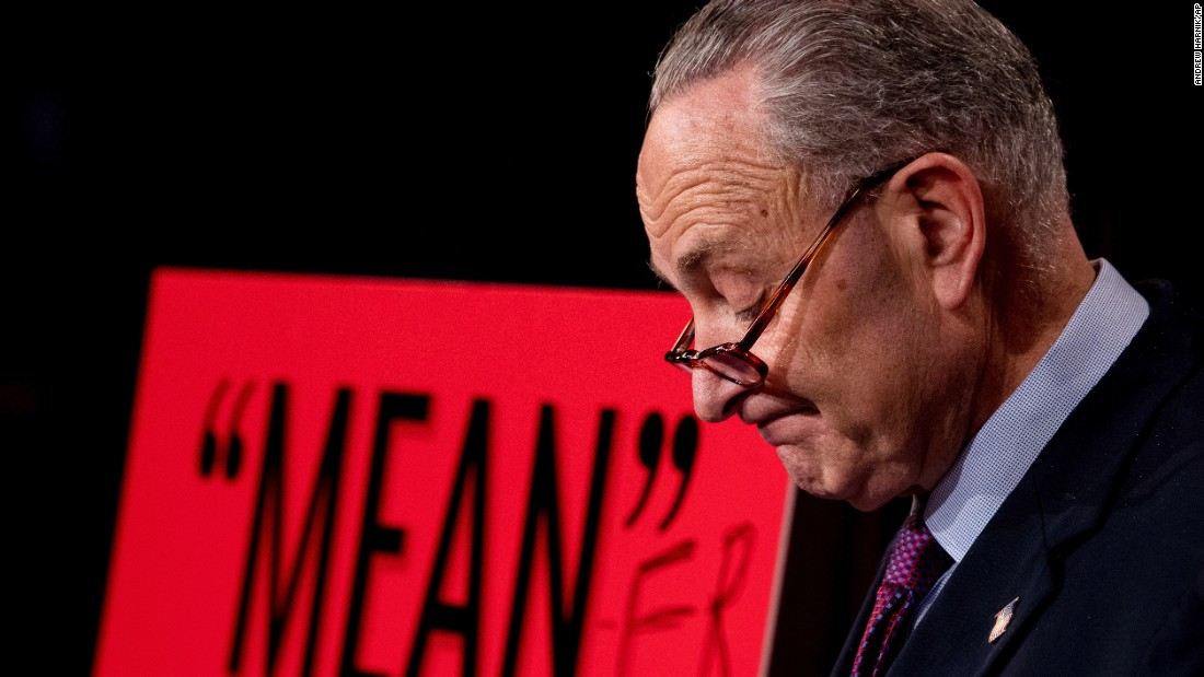 "Senate Minority Leader Chuck Schumer pauses during a news conference responding to the Senate GOP's <a href=""http://www.cnn.com/2017/06/22/politics/senate-health-care-bill/index.html"" target=""_blank"">new health care bill</a> on Thursday, June 22. Schumer brought in a poster board with the word ""mean"" written on it, quoting what President Donald Trump <a href=""http://www.cnn.com/2017/06/13/politics/trump-senators-health-care-white-house-meeting/index.html"" target=""_blank"">reportedly said</a> about the House's failed bill earlier this year. Schumer added the letters ""er,"" saying the Senate GOP's bill is ""nasty"" and ""heartless."""