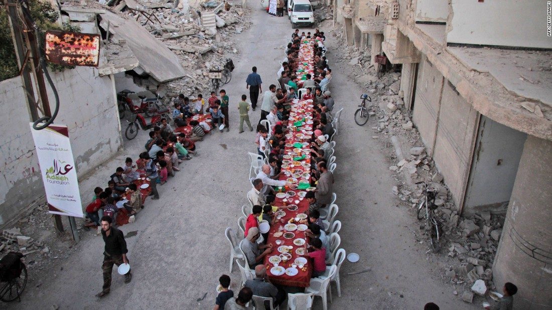 Residents of the war-torn city of Douma, Syria, break their Ramadan fast on Sunday, June 18. Ramadan, the most sacred month in the Muslim year, ends on June 24.