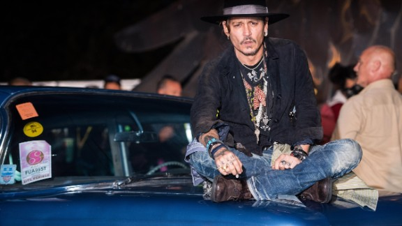 "GLASTONBURY, ENGLAND - JUNE 22:  Johnny Depp indruduces a screening of ""The Libertine"" film at the Cineramageddon cinema on day 1 of the Glastonbury Festival 2017 at Worthy Farm, Pilton on June 22, 2017 in Glastonbury, England.  (Photo by Ian Gavan/Getty Images)"