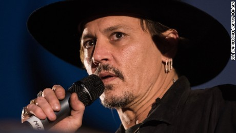 Actor Johnny Depp introduces his film, The Libertine, to the audience at 'Cineramageddon', the outdoor cinema venue, at the Glastonbury Festival of Music and Performing Arts on Worthy Farm near the village of Pilton in Somerset, South West England, on June 22, 2017.