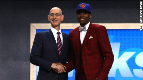 Frank Ntilikina walks on stage with NBA commissioner Adam Silver after being drafted.