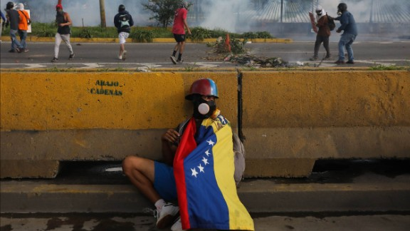 A protester hides behind a barrier in Caracas on June 22.