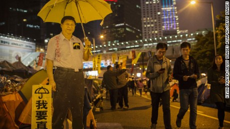 A carboard cutout of Chinese President Xi Jinping holding a yellow umbrella seen at a protest site in Hong Kong's Admiralty district on November 12, 2014.