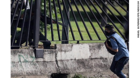 David José Vallenilla, 22, is shot during a protest Thursday outside La Carlota airbase in Caracas.