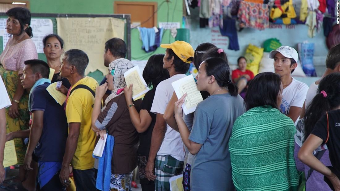 Internally displaced peoples (IDPs) line up at a makeshift camp in Barangay Maria Christina, Iligan City.