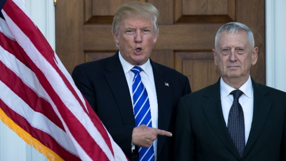 Donald Trump welcomes retired United States Marine Corps general James Mattis as they pose for a photo before their meeting at Trump International Golf Club, November 19, 2016 in Bedminster Township, New Jersey.