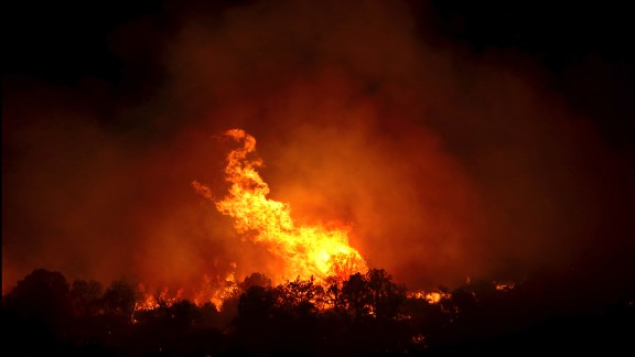 A large tree goes up in flames along a ridge line, eight miles south-southeast of Patagonia, Arizona in the Coronado National Forest, June 14, 2017. The fire was reported at noon Wednesday and is burning in brush, grass and timber.  (Kelly Presnell  /Arizona Daily Star via AP)