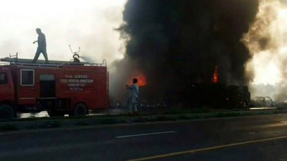 A tanker truck caught fire then exploded after running off the road and overturning near the eastern Pakistani village of Bahawalpur on Sunday, June 25. Before the explosion, villagers had surrounded the truck to collect spilled fuel.