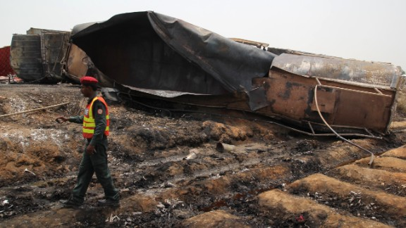 A Pakistani rescue worker walks by what remains of the tanker truck.