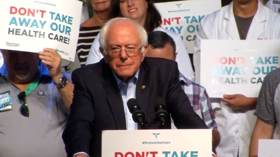 "Senator Bernie Sanders speaks at a stop on the ""Don't Take our Health Care"" bus tour in Columbus, Ohio on June 25."