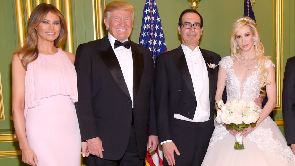 WASHINGTON, DC - JUNE 24: (Exclusive Coverage) (L-R) First Lady Melania Trump, President Donald Trump, Secretary of the Treasury Steven Mnuchin, Louise Linton, Vice President Mike Pence, and Second Lady Karen Pence pose at the wedding of Secretary of the Treasury Steven Mnuchin and Louise Linton on June 24, 2017 at Andrew Mellon Auditorium in Washington, DC. Louise Linton is wearing a custom Ines DiSanto gown with wedding ring and earrings by Martin Katz.  (Photo by Kevin Mazur/Getty Images for LS)