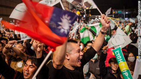 TAIPEI, TAIWAN - JANUARY 16: Supporters shout as they attend at DPP headquarters during Tsai Ing-wen speach her election victory on January 16, 2016 in Taipei, Taiwan. Tsai Ing-wen, the chairwoman of the opposition Democratic Progressive Party, has won the presidential election to become the Taiwan's first female president.  (Photo by Ulet Ifansasti/Getty Images)