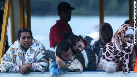 Survivors are seen after the tourist boat Almirante sank in the Reservoir of Penol in Guatape municipality in Antioquia on June 25, 2017.