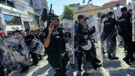 Turkish riot police officers block activists as they try to gather for the pride parade.
