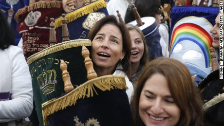 The religious group Women of the Wall, with a Torah scroll in the women's section of the Western Wall