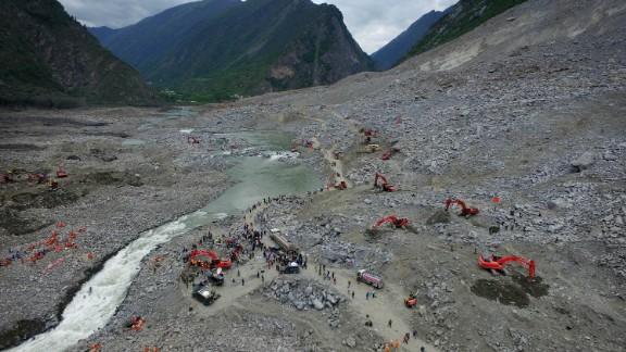 Chinese rescuers search for survivors at a landslide area in the village of Xinmo in Maoxian county, China's Sichuan province on June 25, 2017.