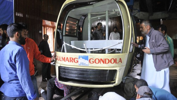 Officials check the damaged cable car