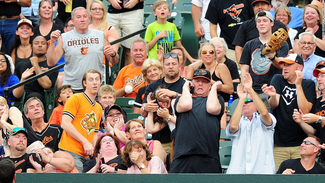 Fans react as a foul ball lands near them in Baltimore on Thursday, June 22.