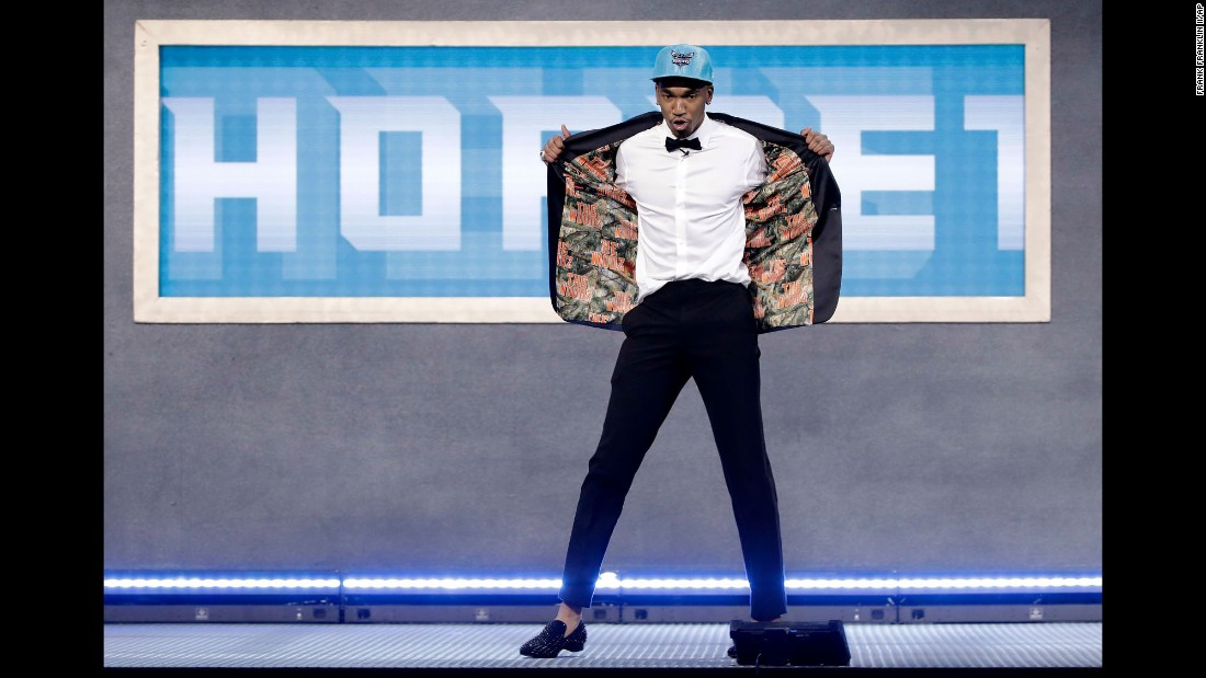 "Malik Monk shows off his jacket after the Charlotte Hornets took the former Kentucky star 11th in the NBA Draft on Thursday, June 22. The jacket paid homage to ""The Woodz,"" <a href=""http://www.kentucky.com/sports/college/kentucky-sports/ex-cats/article158183989.html"" target=""_blank"">Monk's neighborhood court </a>growing up in Arkansas."