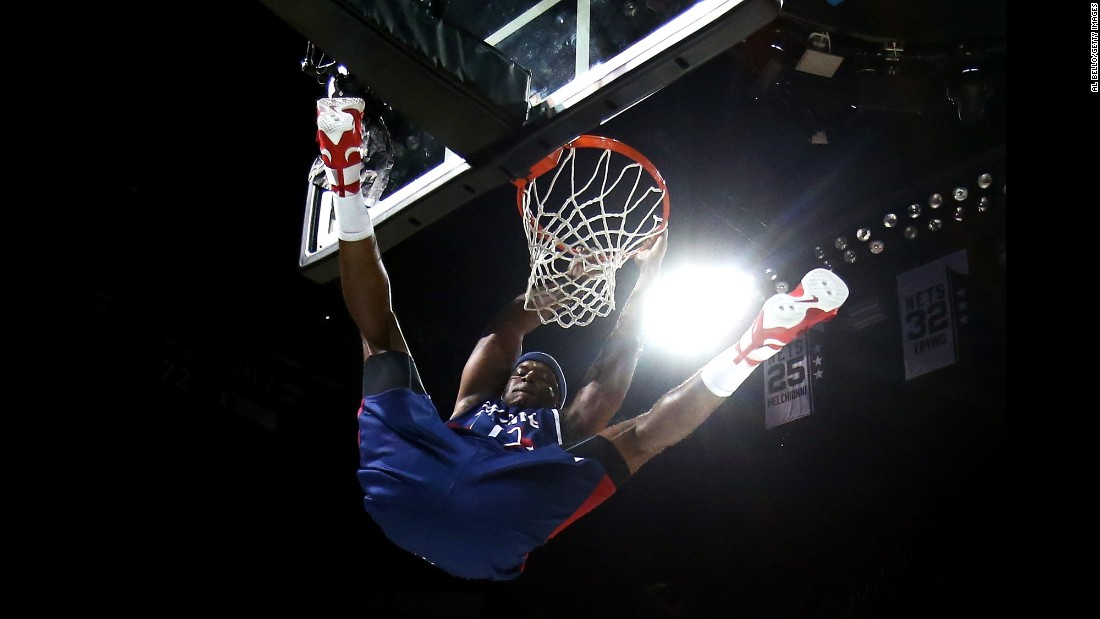 Former NBA star Jermaine O'Neal throws down a dunk during a Big 3 basketball game in New York on Sunday, June 25. The three-on-three basketball league, featuring many former NBA stars, made its debut last week.