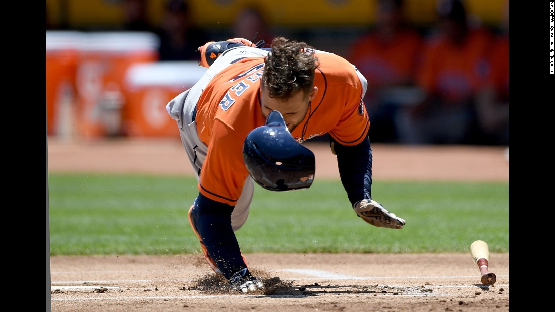 Houston's George Springer falls to the ground after his hand was hit by a pitch in Oakland, California, on Thursday, June 22. The injury forced him to leave the game, but X-rays were negative.