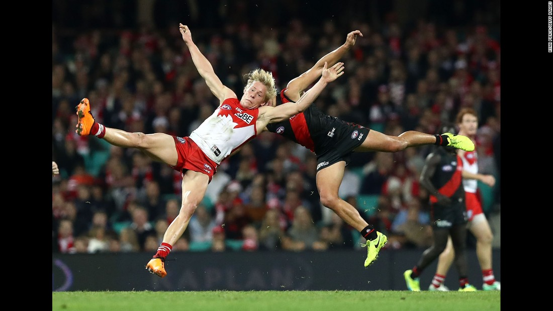 Sydney's Isaac Heeney, left, and Essendon's Mark Baguley collide during an Australian Football League match on Friday, June 23.