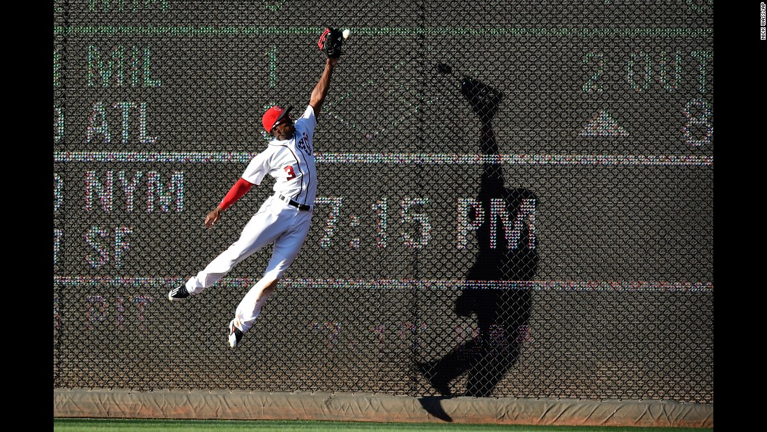 Washington center fielder Michael Taylor leaps for a ball during a Major League game on Saturday, June 24. Cincinnati's Scooter Gennett doubled on the play.