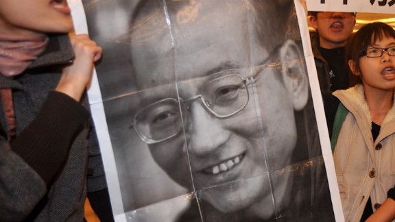 A poster of Liu Xiaobo is held up during a protest in Hong Kong.