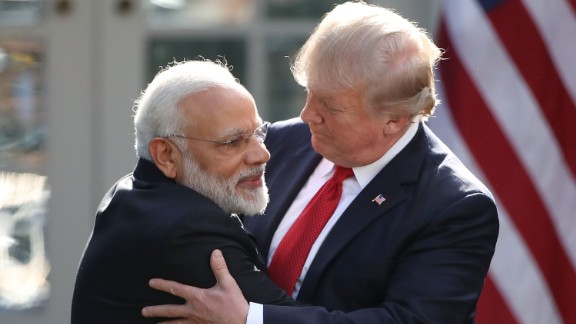 US President Donald Trump and Indian Prime Minister Narendra Modi embrace while delivering joint statements in the Rose Garden, June 26, 2017.