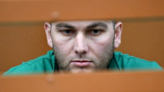 Accused Shadid Gubashev stands inside a defendants' cage at a court hearing in Moscow on Tuesday.