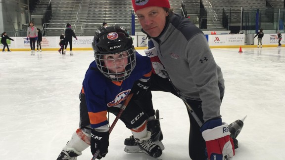 Routine visits with cardiologist Dr. Sean Levchuck are key to helping Jack maintain his love of sports such as hockey, swimming. running and riding his bike.
