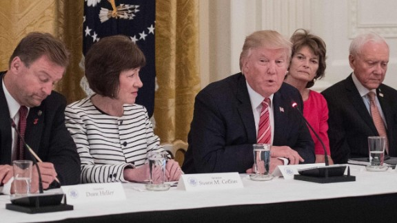 President Trump with, from left, US Sens. Joni Ernst of Iowa, Dean Heller of Nevada, Susan Collins of Maine, Lisa Murkowski of Alaska,  Orrin Hatch of Utah  and Cory Gardner of Colorado as Republican senators meet with Trump to discuss the health care bill.
