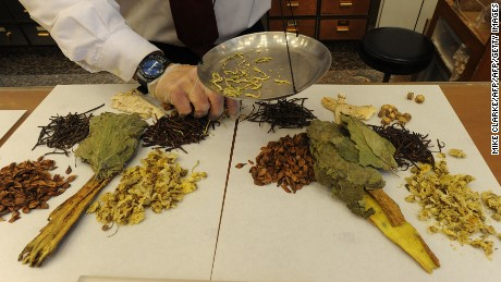 Workers at a Traditional Chinese Medicine store prepare various dried items, Hong Kong, December 29, 2010.