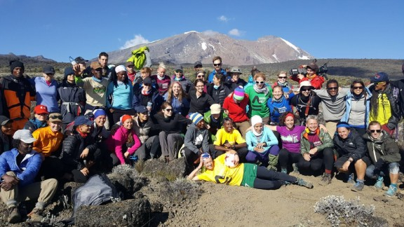 Female footballers celebrate on Mount Kilimanjaro after breaking the world record for the highest match ever played