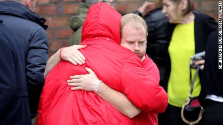 Family members react after the families of the 96 Hillsborough victims were told the decision that the Crown Prosecution Service will proceed with criminal charges.