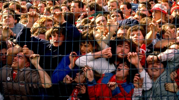 Supporters are crushed against the barrier as disaster strikes before the FA Cup semi-final match.