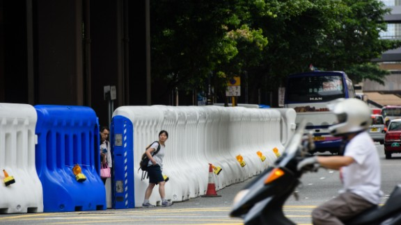 Huge barriers have been erected in central Hong Kong ahead of a visit by Chinese President Xi Jinping.