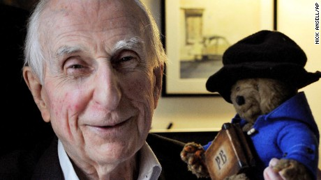 Bond poses with a toy version of Paddington Bear in 2015.